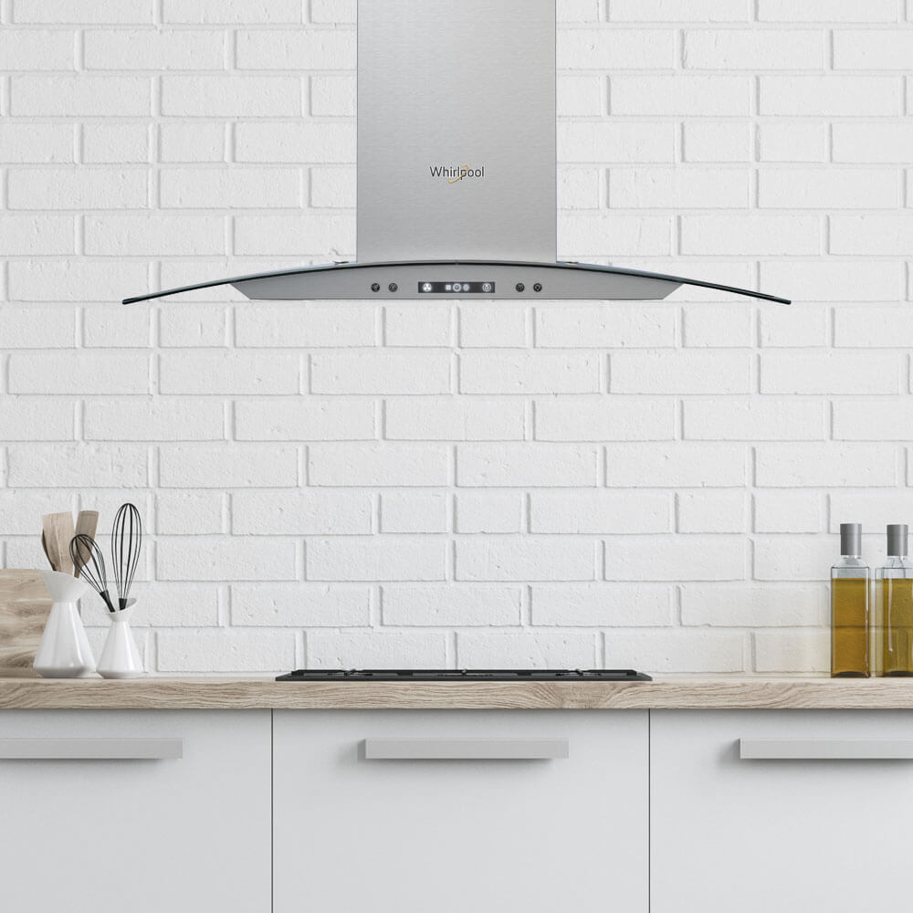 Campana Whirlpool 7501545629648 de pared con vidrio curvo y 94,5 cm de ancho para una mayor covertura de extracción.