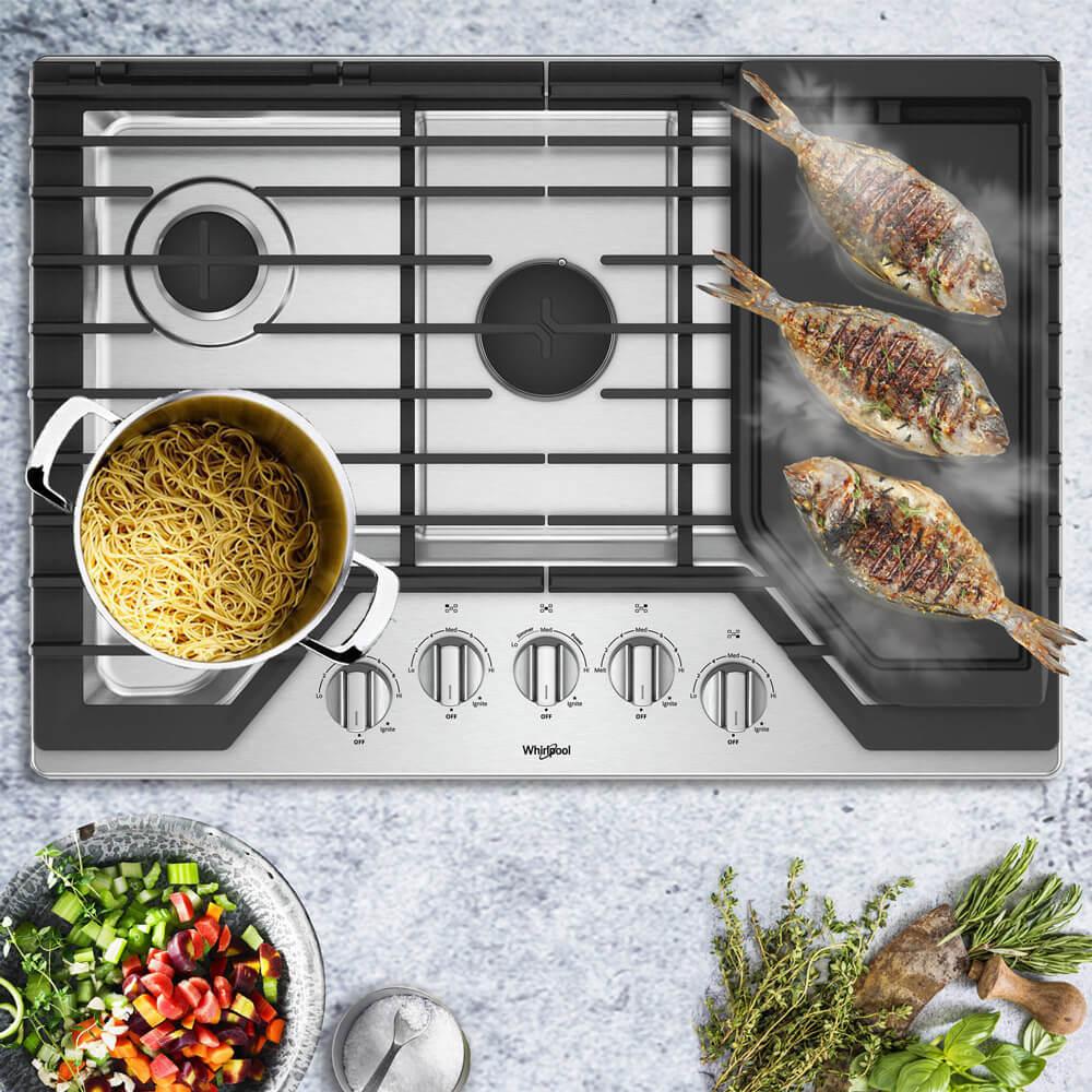 Cubiertas Whirlpool 883049467061 con capacidad para 5 puestos en acero inoxidable. Un quemador central de mayor capacidad y espacio para mejor comodidad al cocinar. Como extra cuenta con una plancha para cocciones más saludables y más eficientes en la distribución de calor.